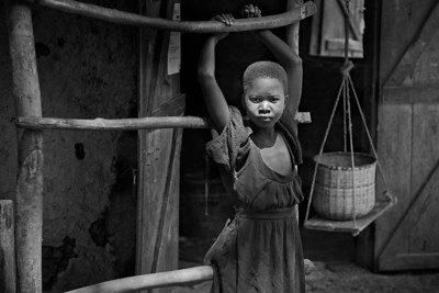 Young village girl and basket, Ugenya, Kenya