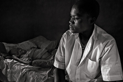 Lost in thought. Son/caregiver of dying AIDS patient. Ugenya, Kenya