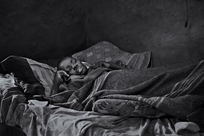 HIV/AIDS patient near death, home visit, rural health initiative. Ugenya, Kenya