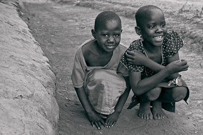 Hopscotch girlfriends, resting. Ukwala, Kenya