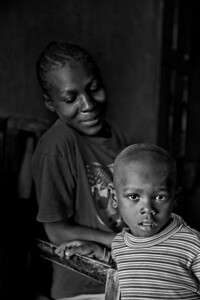 Proud mother and young son. Rural health initiative HIV/AIDS. Ugenya, Kenya