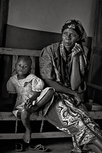 Family visit, rural health initiative HIV/AIDS. Grandmother and child. Ugenya, Kenya