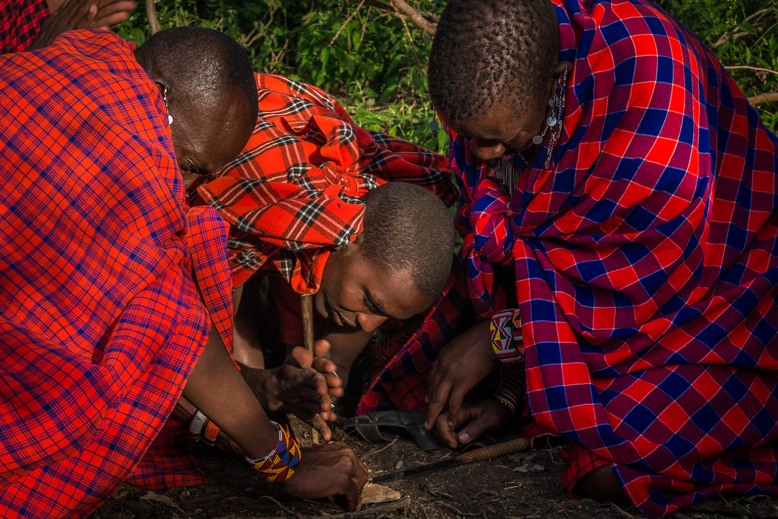 the Maasai lighting a fire by hand