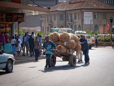 Street scene in Nairobi.  A cart load of potatoes.