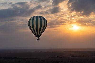 Hot air balloon at sunrise over the Maasai Mara