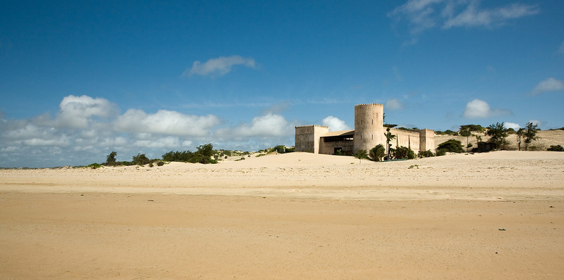 Just off the beach - 15kms of undeveloped and empty sand - was this castle, surrounded by sand dunes. Though in actuality a private residence/tourist lodge - known as The Fort - I didn't find it offensive or detractive to the scene.<br /> <br /> Location: Shela, Lamu island, Kenya<br /> <br /> Lens used: 10-22mm f3.5-4.5