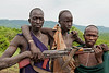 Surma herdsman and weapon