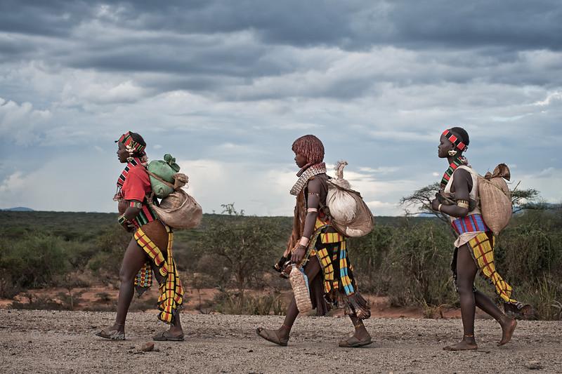 Market Day. Hamer girls walking home near Turmi, SNNPR, Ethiopia