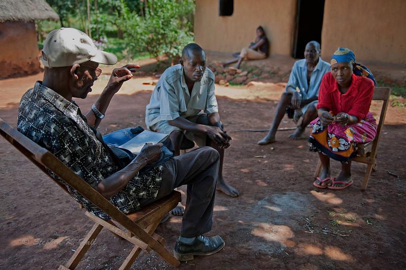 Impromptu HIV counselling session during rural health initiative village rounds. Ugenya, Kenya