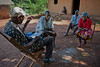 Impromptu HIV counselling session during rural health initiative village rounds. Ugenya, Kenya