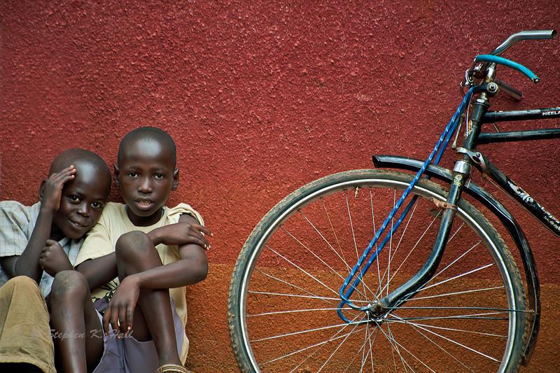 Young friends and bicycle. Ukwala, Kenya