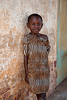 Young girl in striped dress. Obeth, Ugenya, Kenya