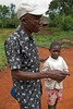 Sadimba and patient. Village rounds. Rural health initiative. Ugenya, Kenya.