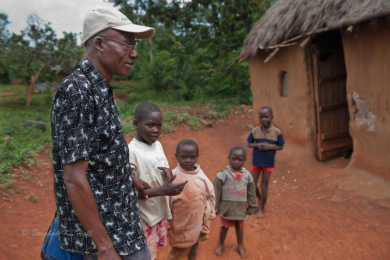Sadimba, rural health volunteer making rounds in the village. Ugenya, Kenya.