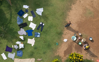Aerial photo of a woman doing laundry in Monrovia (photo by: Christopher Herwig)