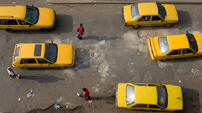 UNMIL Photo/Christopher Herwig,  2009, Monrovia, Liberia - Traffic dodging potholes on Broad street in downtown Monrovia which is due to be repaired by a project in cooperation with the World Bank.