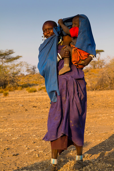 "Maasai woman.  Blue and purple robes are traditional for women, but now are ""in Vogue"" for men also."