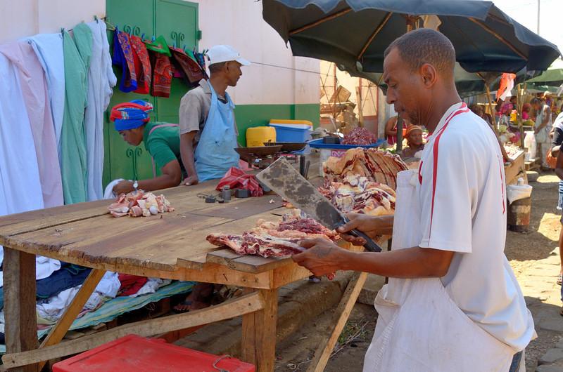 A butcher cutting up Zebu in the Antsiranana Market