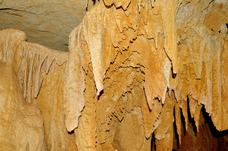 Most of the speleothem in the bat cave is flowstone draperies but there are also stalactites and stalagmites