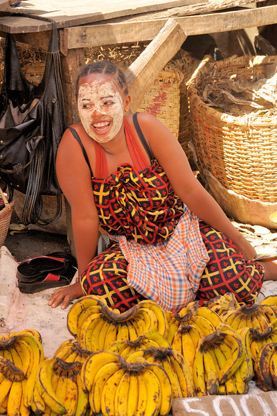 A banana vendor in her beauty mask