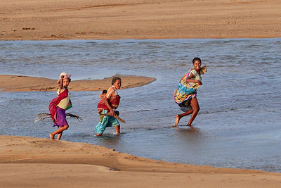 Family Crossing the River Bed