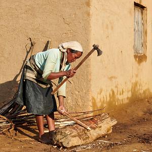 Woman Chopping Wood