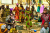 Colourful market dominated by women.