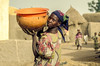 Woman with calabash in village