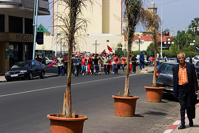 <center>Soccer Fans   <br><br>Casablanca, Morocco   <br><br>As we boarded our bus for an afternoon tour of Casablanca, we spotted this gang of soccer fans parading down the main street in front of the hotel.    </center>