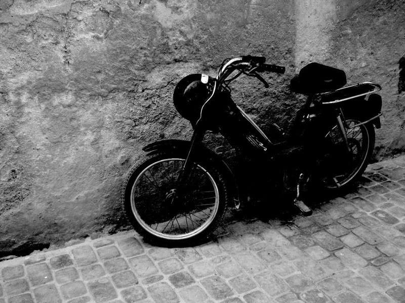 A parked motorcycle in Essaouira, Morocco.
