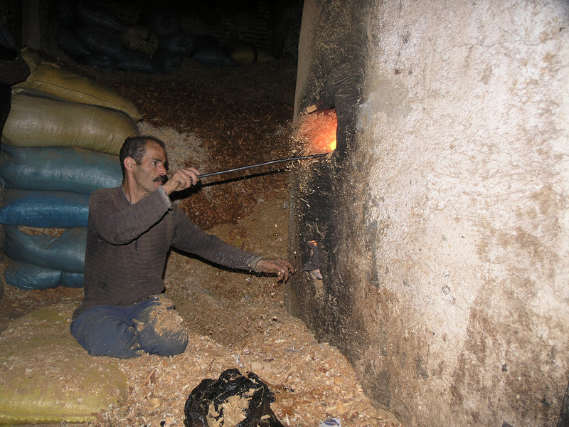 This guy continually  throws woodchips into the small hole for a living.  The fire heats water to the hammam (spa).