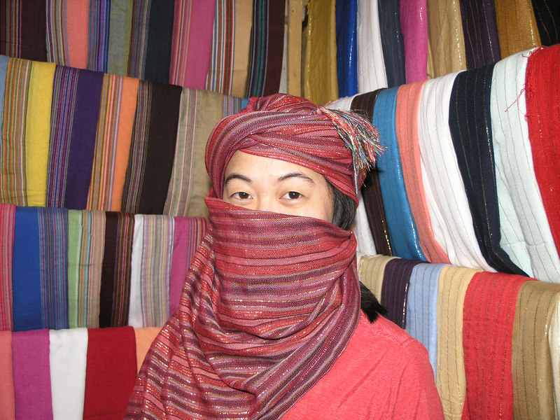 Catie buying scarves in the souk.
