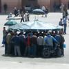 Men at a stand in Djemaa El-Fna, Marrakesh.