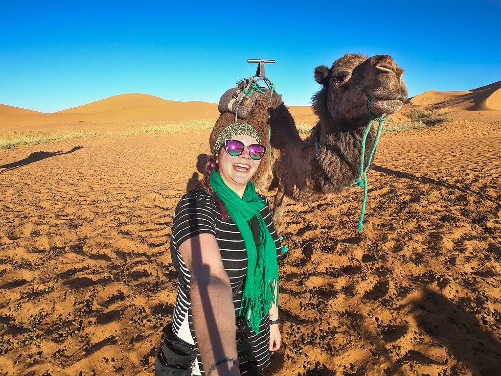 Amanda and a camel in the Sahara Desert