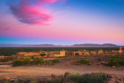 Sunset above a moroccan village with Atlas mountains in the background