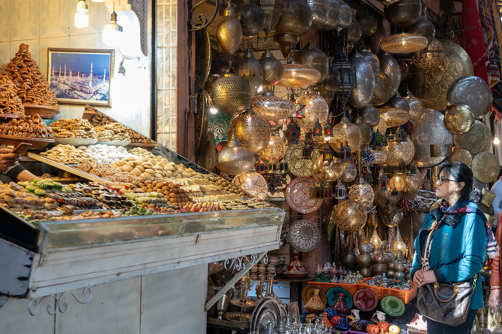 Lamps and pastries for sale in the Marrakech medina