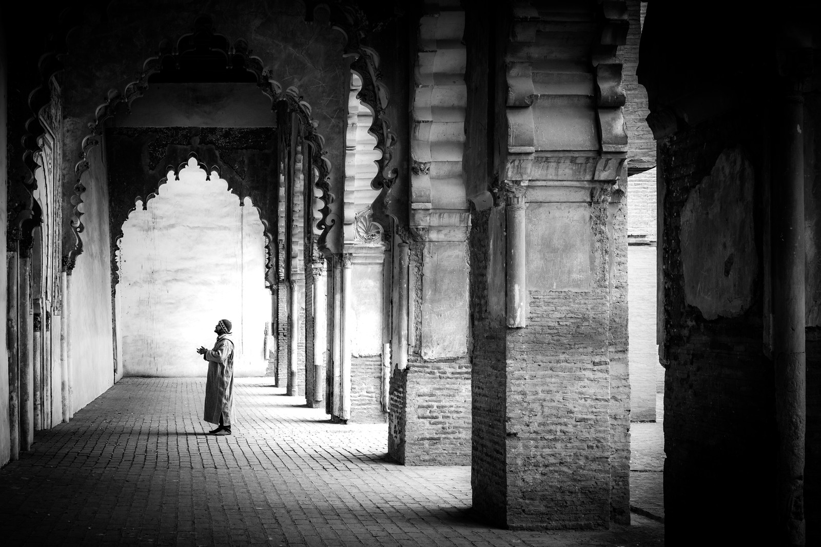 worshiper at Tinmel Mosque in Morocco - cycling vacation and photography tour with Kevin Wenning