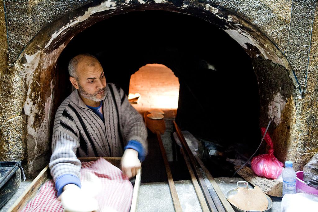 baker in marrakech baking bread