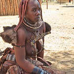 After a year of marriage or giving birth to their first child, Himba women add an elaborate headdress to their hairstyle