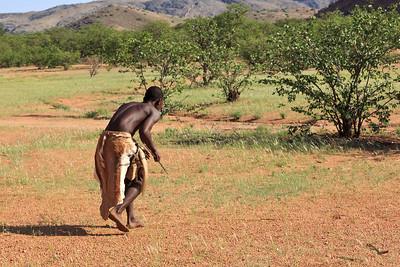 Damara hunter demonstrating his skills