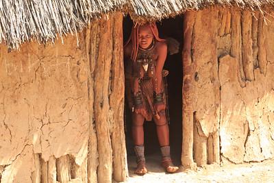 Himba woman in doorway