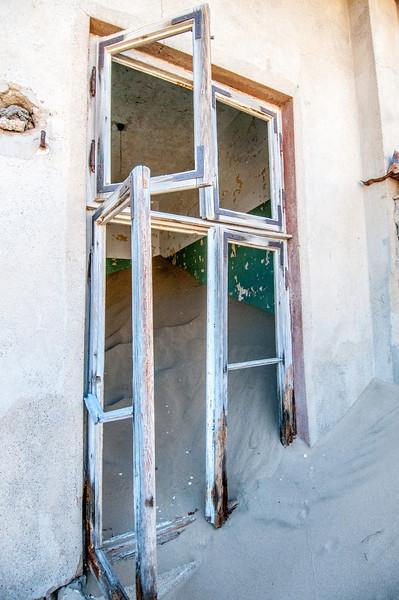 Window of abandoned building in Kolmanskopf, Luderitz, Namibia