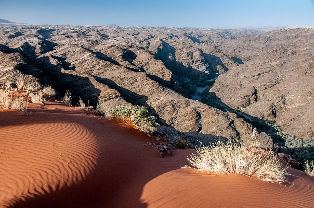 Sand dunes and rock formations at Namib Desert