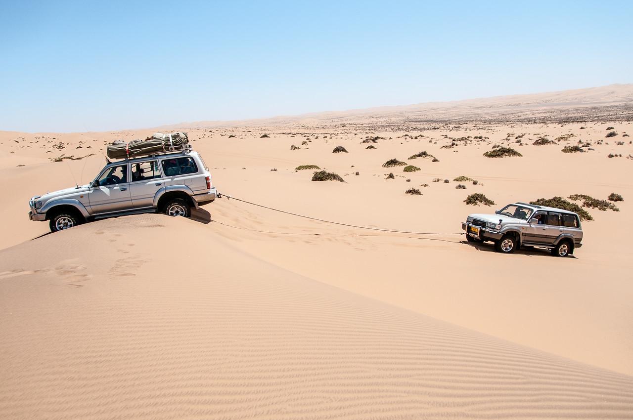 Driving along the sand dunes of Namib Desert