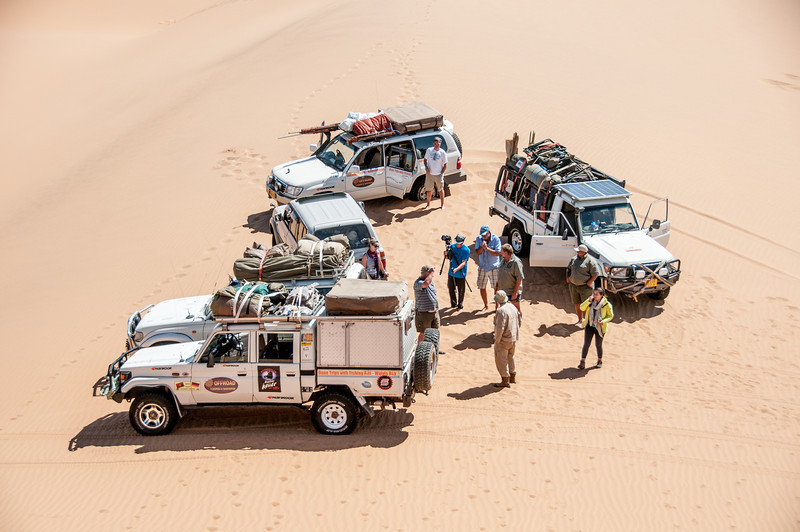 Group of vehicles at the sand dunes of Namib Desert