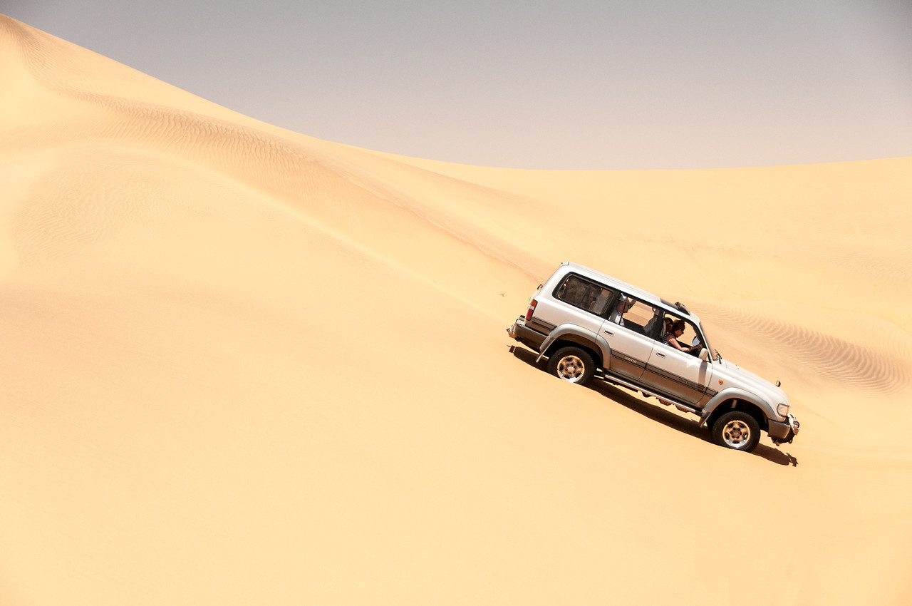 Driving through sand dunes in Namib Desert
