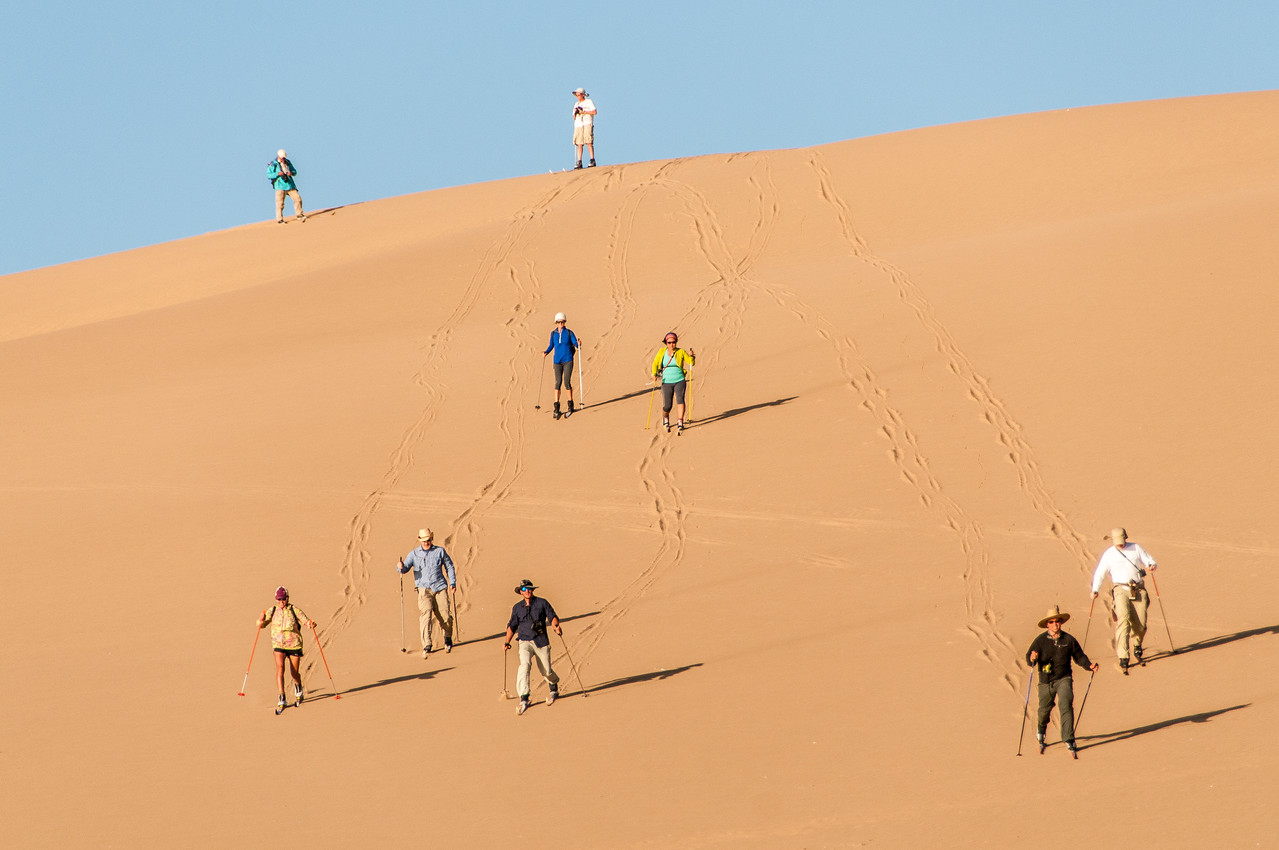 Skiing at the sand dunes of Namib Desert