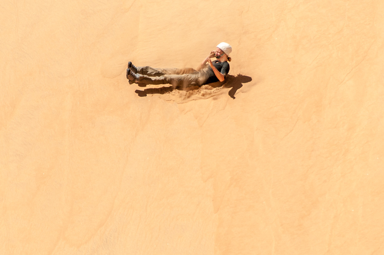 Sand boarding at the dunes of Namib Desert