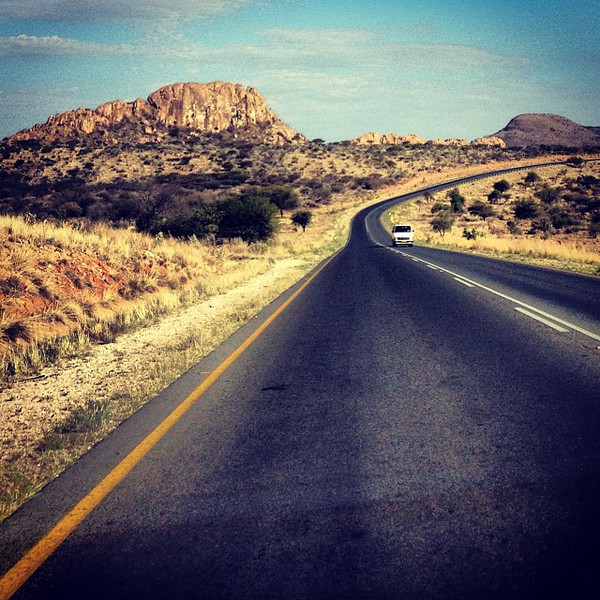 Windhoek to further into the Kalahari. Sometimes, an unusual sight in Namibia, a curve in the road. #2013ATWS