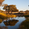 A quiet reflecting lake in late afternoon light, found on a remote side road on the way to Sossusvlei, Namibia, 2010